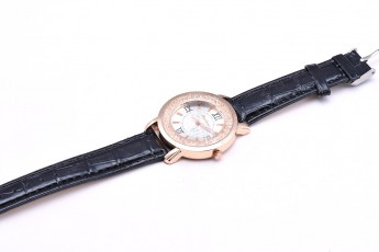 Womens - Rose gold dial watch